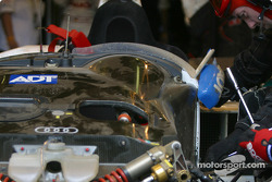 Champion Racing crew work on the damaged #2 Audi R8