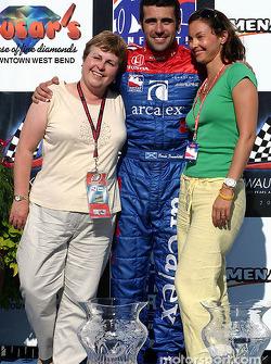 Victory lane: race winner Dario Franchitti with wife Ashley