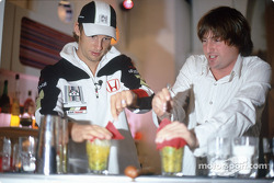 Jenson Button tries his hand, bartending
