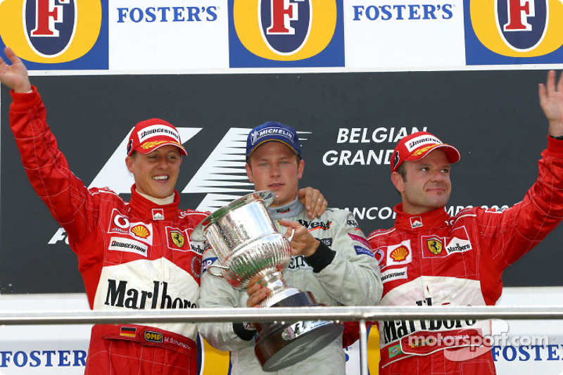 Podio: il vincitore della gara Kimi Raikkonen con Michael Schumacher e Rubens Barrichello