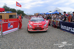 Marcus Gronholm and Timo Rautiainen arrive at service park in Obihiro