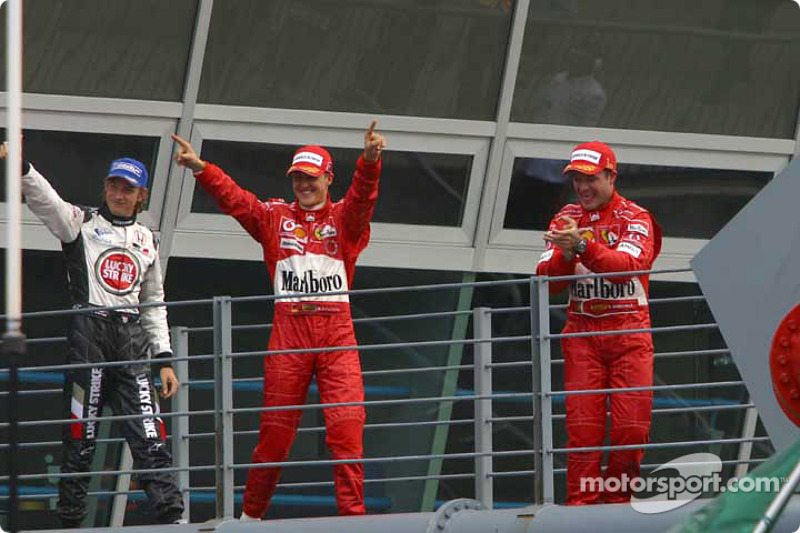 2004. Подіум: 1. Рубенс Баррікелло, Ferrari. 2. Міхаель Шумахер, Ferrari. 3. Дженсон Баттон, BAR-Honda
