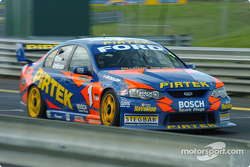 Marcos Ambrose on his way to taking the chequered flag for the Betta Electrical 500