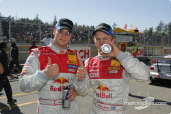 Mattias Ekström celebrates pole position with Martin Tomczyk