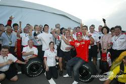 Rubens Barrichello celebrates with Bridgestone team members