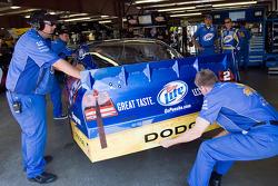 Penske Racing Dodge crew members at work while Kurt Busch, Penske Racing Dodge, watches on