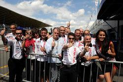LCR Honda MotoGP team members celebrate second place in qualifying for Randy De Puniet, LCR Honda MotoGP