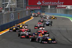 Sebastian Vettel, Red Bull Racing leads Lewis Hamilton, McLaren Mercedes at the start of the race