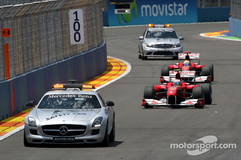 The medical and safety car are sent out after the crash of Mark Webber, Red Bull Racing, as they pas