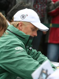 Heikki Kovalainen signing autographs