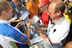 Mikko Hirvonen is swamped by autograph hunters