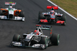 Michael Schumacher, Mercedes GP leads Jenson Button, McLaren Mercedes
