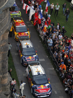 Cars wait at the ceremonial start podium