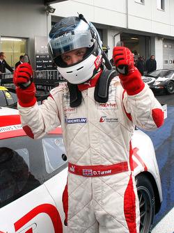 Qualifying race winner Darren Turner celebrates