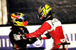 Esteban Gutierrez celebrates victory in parc ferme with Rio Haryanto