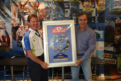 Two times World Rally Champion, Carlos Sainz presents Malcolm Wilson with a special plaque to celebrate M-Sport's 200th WRC event