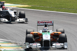 Adrian Sutil, Force India F1 Team leads Michael Schumacher, Mercedes GP