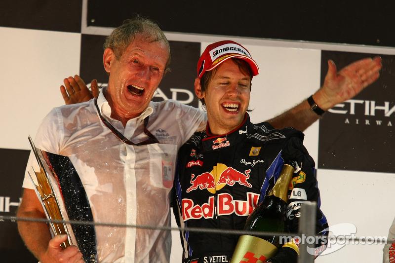 Podium: race winner and 2010 Formula One World Champion Sebastian Vettel, Red Bull Racing, with Helmut Marko, Red Bull Racing, Red Bull Advisor