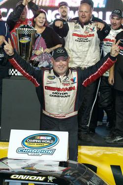 Championship victory lane: 2010 NASCAR Camping World Truck Series champion Todd Bodine celebrates