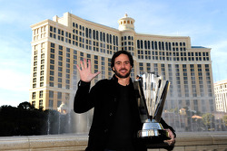 Five-time NASCAR Sprint Cup Series Champion Jimmie Johnson poses with the 2010 trophy outside the Bellagio Hotel and Casino Resort