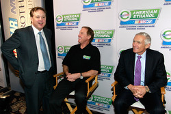 NASCAR Chairman and CEO Brian France speaks with television personality Rusty Wallace and General Wesley Clark after announcing that American Ethanol led by Growth Energy will become an Official Partner of NASCAR
