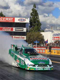 John Force during his burnout in his GTX High Mileage Ford Mustang Funny Car