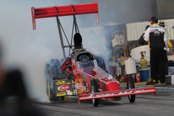 Ron August doing a burnout in his Hartley Racing Top Fuel Dragster