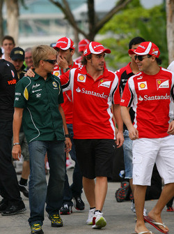 Heikki Kovalainen, Team Lotus with Fernando Alonso, Scuderia Ferrari and Felipe Massa, Scuderia Ferrari
