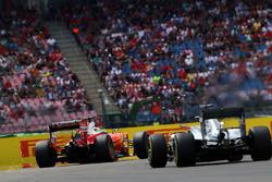 Sebastian Vettel, Ferrari SF16-H leads Lewis Hamilton, Mercedes AMG F1 W07 Hybrid
