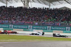 Lewis Hamilton, Mercedes AMG F1 W07 Hybrid leads at the start of the race as Nico Rosberg, Mercedes AMG F1 W07 Hybrid and Sebastian Vettel, Ferrari SF16-H collide