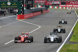 Kimi Raikkonen, Ferrari SF16-H and Felipe Massa, Williams FW38 battle for position