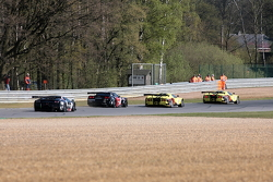 And trouble in the first curve: #8 Young Driver Aston Martin and #37 All-Ink Lamborghini Murcielago pushed each other out of the track