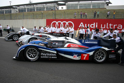 #7 Peugeot Sport Total Peugeot 908 parked right next to the Audi R18 TDI during the Audi Sport photoshoot