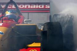 Race winner Sébastien Bourdais celebrates with doughnuts