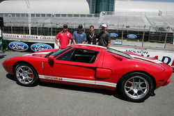 Molson Indy 2005 media event: Jimmy Vasser, Paul Tracy and Sébastien Bourdais pose  with the Ford GT pace car for the Molson Indy 2005