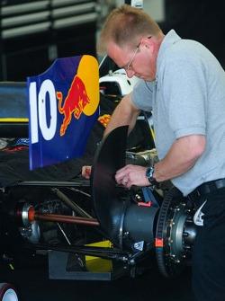 RuSPORT mechanic works on #10 car of A.J. Allmendinger