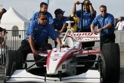 Dale Coyne Racing team members push the car