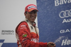 Podium: champagne for Justin Wilson