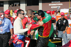 Victory lane: race winner Bryan Herta celebrates with Tony Kanaan and Dario Franchitti