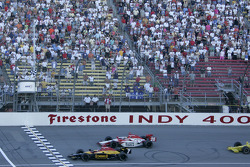Bryan Herta takes the checkered flag ahead of Dan Wheldon