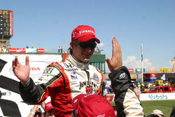 Dan Wheldon celebrates in Victory Lane