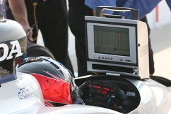 Ed Carpenter watches timing and scoring from the cockpit