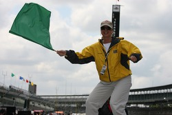 Honorary starter for the day, local radio personality Terri Stacy waves the green flag