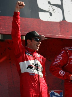 Podium: race winner Helio Castroneves celebrates