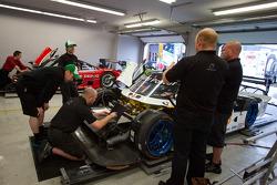 AIM Autosport team members at work