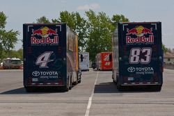 The NASCAR race haulers wait to enter the Dover International Speedway