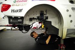 A BMW mechanic works on Andy Priaulx's M3