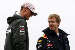 Michael Schumacher, Mercedes GP Petronas and Sebastian Vettel, Red Bull Racing