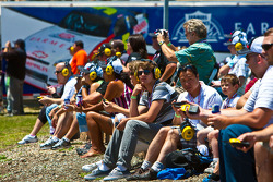 Fans using headsets and scanners to follow the race action