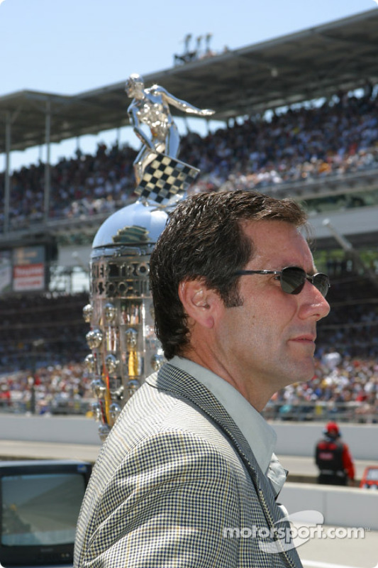 Tony George in front of the Borg-Warner trophy